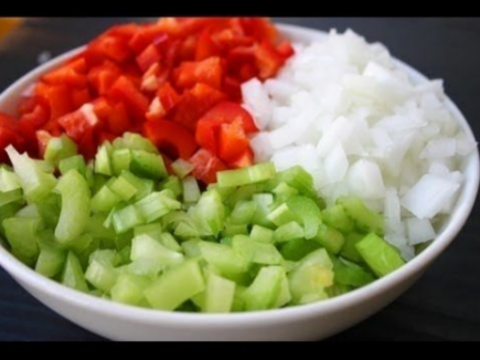 This photo is of a bowl of onions, celery, and bell peppers.